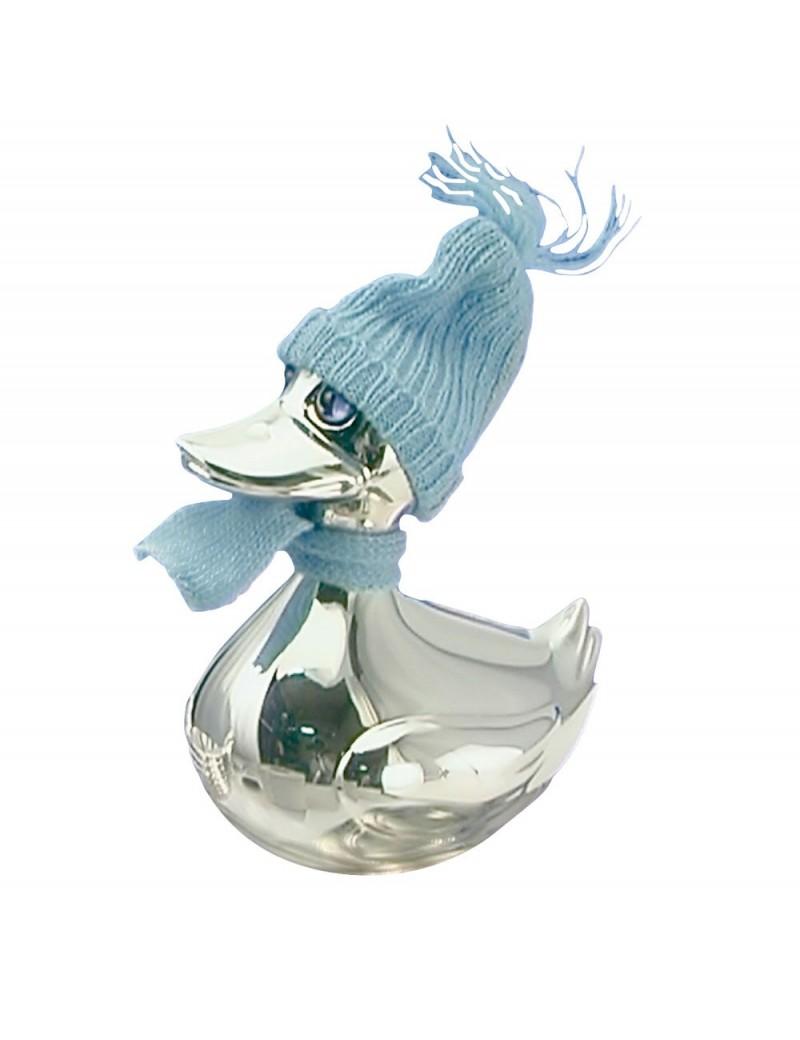 And i sølv plet med blå hat og halstørklæde